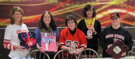 Red Shoe Society volunteers: Mary Hinkelman, Beth Joseph, Mary Jimison, Amanda Rinearson, and Nicole Burns display PJ's and Snowman Soup