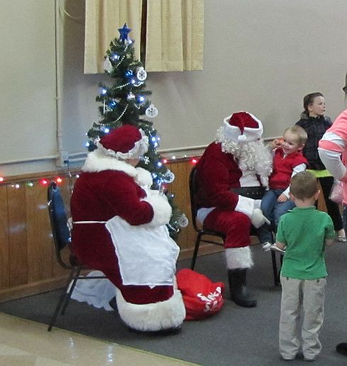 Gotta love the smile of a young child on Santa's lap!