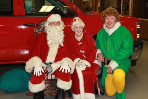 Santa and Mrs. Claus with Buddy the Elf
