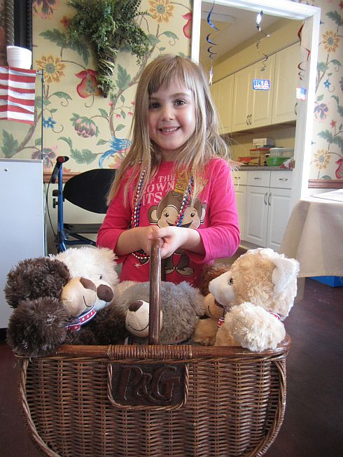 Leah Trout and her basket of Teddy Bears