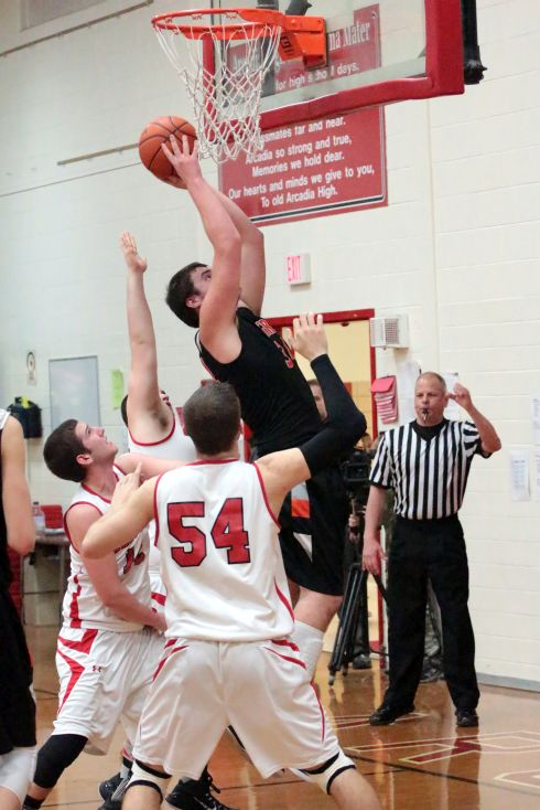 Derek McMahan hits the shot and gets fouled