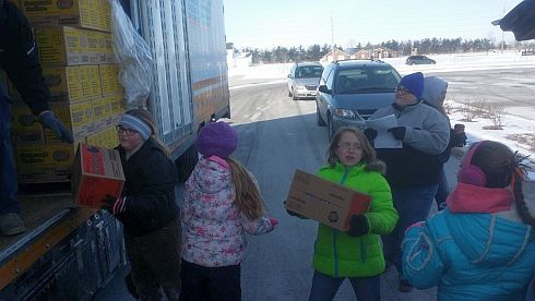 Girl Scout cookie unloading 2