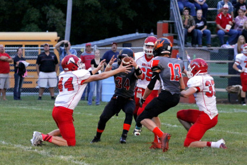 The Arcadia player couldn't handle the punt and the ball takes a fortuitous bounce into Andrew Hollinger's hands!