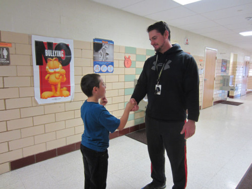 Zach Walls, our Powell physical education teacher, accepts a special thank you from Timothy Keeton.