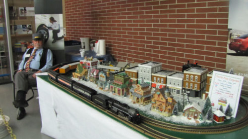 """""""Conductor"""" Larry brought two of his trains for everyone to enjoy while waiting in line"""