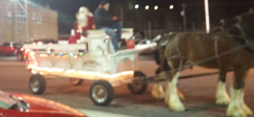 Santa and Mrs. Claus arrived in a horse-drawn wagon