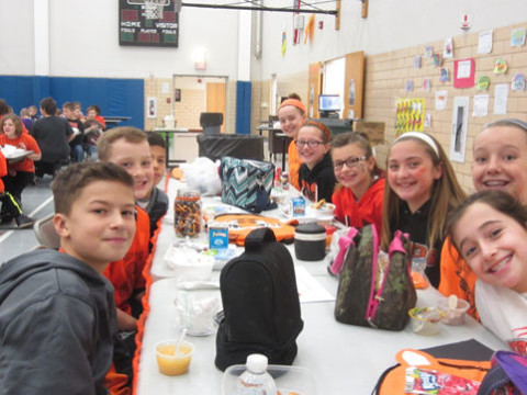 Sixth graders are all smiles at the Scholar's Luncheon.