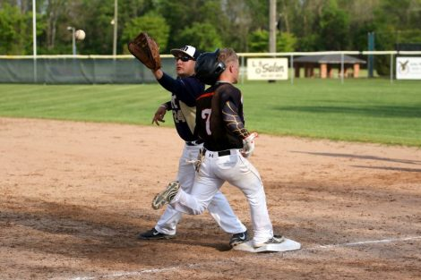 Baseball District A hustling Andrew Hollinger beats the throw to first