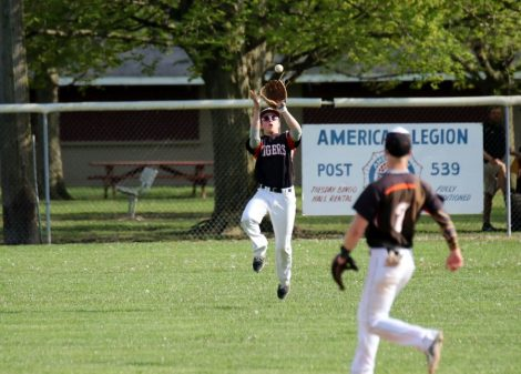 Baseball District Rightfielder Chase Naugle catches the fly ball