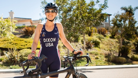 Top paratriathlete carries the torch for healthy vision to Tokyo